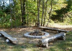 Fire ring with rustic seating thanks to re-purposed cedar logs, Lincoln log style.