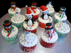 Christmas Penguin And Snowmen Cupcakes  on Cake Central