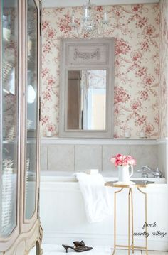 Red, floral toile gives the bathroom a warm, French country feel. RELATED: Peek Inside a Renovated Texas Cottage