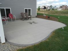 Attirant Simple Concrete Patio Ideas With Red Chair And Brown Chair