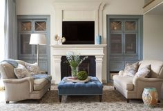 How to Choose Oversized Ottoman for Your Living Room: Blue Oversized Ottoman With Beige Armchairs And Area Rugs Plus Fireplace Mantel And Tv Over Fireplace Also Blue Cabinets Plus Glass Cabinet Doors And Ceramic Stool ~ franklester.com Bathroom Inspiration
