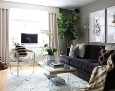 Victoria Solomon's New York City Apartment Tour #theeverygirl Living room - Moroccan rug - dark velvet sofa
