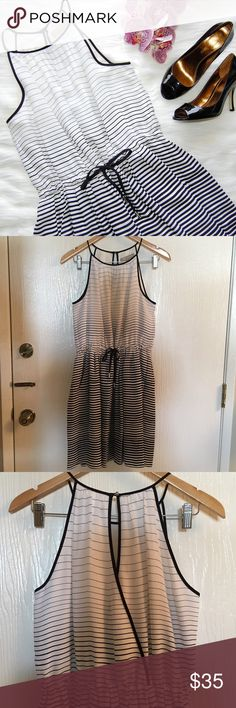 "BANANA REPUBLIC Striped Dress Super cute, soft and flowy black and white ombré striped dress. Halter fit. Drawstring tie waist. Single button detail and wrap in back. Has pockets! Approximately 36"" in length. Small stain and snag on front but you'd have to really look to see it. Worn once. Shell and lining are 100% polyester.  Blog: bringingupsuns.com Instagram: @bringingupsuns Banana Republic Dresses"