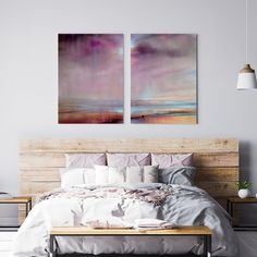Purple is all the rage right now and we LOVE the serene lilac shades running through this stunning landscape art. Taking advantage of our new metal prints, this design and its stunning tones are just perfect as a print! Creating a feature can be as simple as two prints above your headboard. Choose one design you love, and split that piece between two of our metal prints. This will increase the wall space you can cover, whilst splitting up the art for a modern and sleek look.