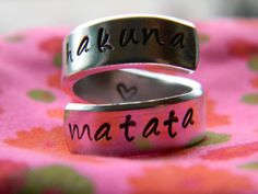 "Hakuna Matata Ring....""Hakuna Matata"" is from The Lion King. It is a Swahili phrase that is literally translated as ""There are no worries"". It is sometimes translated as ""no worries"", although is more commonly used similarly to the English phrase ""no problem""."