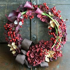 Holly Berries, Pine Cones And Lavender Calla Lilies Make A Pretty Wreath.❤️
