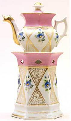 Teapot #394  Hexagonal stand and pot with blue floral in diagonal panels. Pink on base of pot, gold and   animalistic spout.