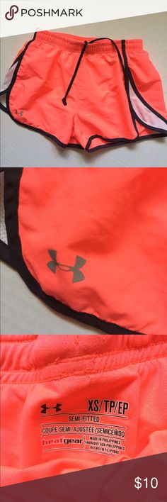 Under Armor fluorescent orange shorts! These are amazing under armor brand shorts! Perfect for any sport this time of year, hiking or just hanging around the house. **stock photo very similar. Not exact** Under Armour Shorts