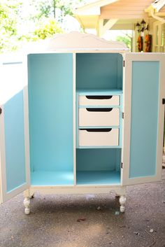 White Painted Wardrobe With Lovely Pop Of Blue Inside. Donu0027t Know What It
