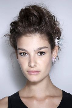 The eyes are the focal point while the rest of the face is soft and romantic at Zac Posen SS 2014