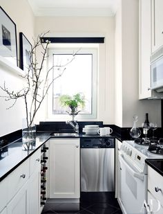 Designer Larry Laslo updated the galley kitchen in a New York apartment with a black-and-white palette.