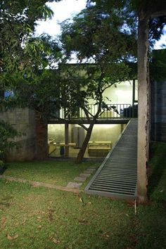 Wisnu & Ndari House  / djuhara + djuhara_ outdoor seating/ dining on ground floor with living space on first floor.