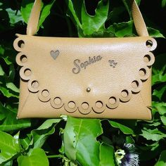 Spoil a young lady in your life with a custom made, hand stitched, genuine leather bag. Decorative edging can be styled in different patterns. www.gregwoodleather.com