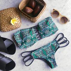 My Bali Essentials: A Cute Bikini, Sunnies, Black Sandals, Mineral Water, & Coconut Oil by Bria.Via