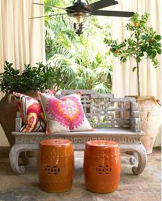 Asian inspired patio decor with orange Chinese garden stools. Photo from Horchow.