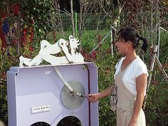 """Woman Operating Interactive Sculpture at Love Land Korea, Exotic Travel You""""ll Enjoy,come check out some nice travel & dating info"""