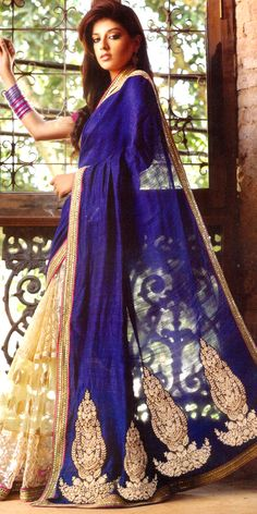 Beautiful Blue colour saree having the fabric of Net and Pure Georgette with artistic Resham Embroidery along with Sequins and Zari worked Patch border giving a dazzling look to the saree, which can be used as both Party and Wedding Saree.