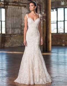 Justin Alexander signature wedding dresses style 9829 Highlight your arms with draped pearl strands attached to this fit and flare gown also showcasing a sweetheart neckline, beaded lace, and sweep train.