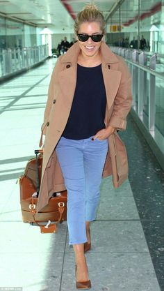 Turning the airport into her runway: Mollie King looked chic as she led the way for her Saturdays bandmates when the group arrived back into the UK on Wednesday morning