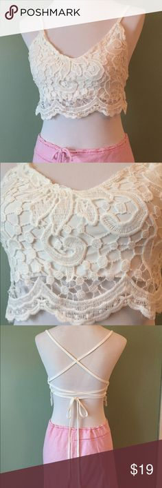 New ivory lace up crop top boho style Brand new, with tags. So extremely pretty. Ivory colored soft lacy- crochet top. Fully lined so you won't need a bra. Lace up back to fit really any size. Awesome for festivals, warm days or even peeking out of a cute sweater for colder weather. Love this top!! I have a few sizes in stock before they sell out. Tops Crop Tops