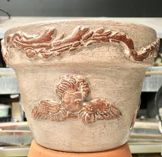 Clay pot embellished with decor moulds, painted and gilded.
