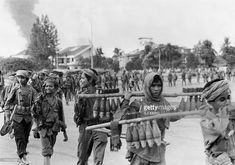 The young Khmer Rouge guerrilla soldiers carry mortar shells 17 April 1975 as they enter Phnom Penh, the day Cambodia fell under the control of the Communist Khmer Rouge forces. The Cambodian capital surrendered after a three and a half-month siege of Pol Pot forces.