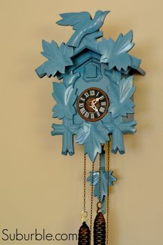 Use spray paint to transform a scratched-up wooden cuckoo clock into gorgeous wall decor! - Suburble