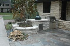 Outdoor kitchen constructed with limestone. #TopekaLandscape
