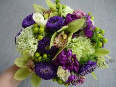 loving the purple and green colors for a wedding right now. Not a big fan of the orchids in this bouquet but everything else is nice.