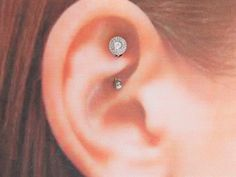 Rook Piercing Information and Inspiration Guide with 21 stunning rook piercing images. Information on rook piercing pain, healing, price, cleaning & care. Ear Piercings Rook, Ears Piercing, Tongue Piercings, Dermal Piercing, Tragus, Peircings, Flower Girl Gifts, Amethyst Crystal, Amanda