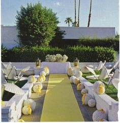 Very pretty yellow and white wedding. Love the all white  pomanders lining the aisle, with just the hint of yellow ribbon.