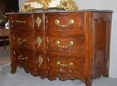 Fine, French, Regence period commode: In solid, carved walnut of arbalette form with original gray marble top.  From Provence.  Early 18th century.