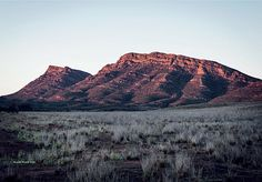 Seven Walks by Tom Carment, photography by Michael Wee Morning at Wilpena Pound, on the 1200km Heysen Trail in South Australia. Wilpena Pound is at the edge of a circular flat valley surrounded by sharp-edged hills, and is not, as is often assumed, the crater of an old volcano.