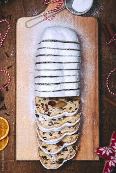 Food: traditional Christmas stollen cake by PavelGr | Stocksy United