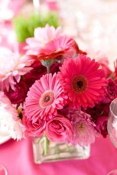 Gerbera daisy and rose centerpieces