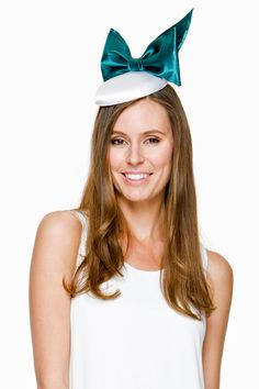 Georgia Verschuer models the 'Mia' turquoise and white My Milliner fascinator