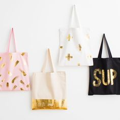 Add a touch of gold to one of these stylish totes using transfer foil and brush-on adhesive, designed specifically for fabrics. This kit comes with twice the materials you need to cover one tote bag so start thinking now about what other fabric, wood, cork, and paper objects you can gild with leftover foil!