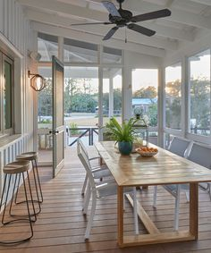 For Sale: This Lowcountry Bungalow Is a Perfect Blend of Farmhouse and Beach House A screened-in porch with an exit to the outdoors and a firepit offer ideal entertaining spaces in the Lowcountry. Br House, House With Porch, House Deck, Porch With Windows, House And Home, Farm House Porch, Bungalow Porch, Dock House, Sunroom Windows