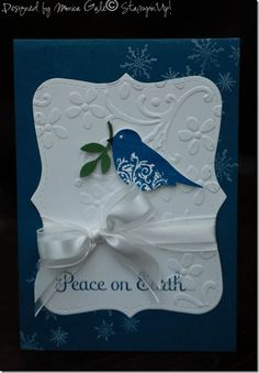 handmade Christmas card ... navy and white ... punched bird with white embossed flourishes ... great contrast in colors ...