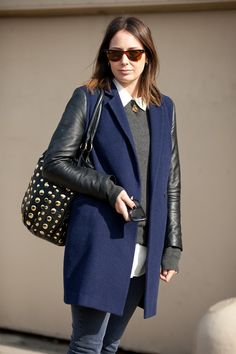 blue coat with black leather sleeves