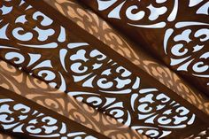 great cut out design for an overhead patio covering. Offering light, but too much, and a cool pattern cast by that light.