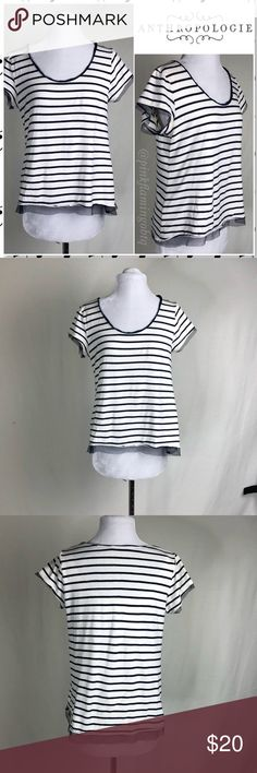 Anthropologie Pilcro Reese Striped With Mesh Tee Anthropologie Pilcro and the Letterpress Reese short sleeve top. Nice stretch knit relaxed fit cotton top in white and navy blue. Has navy mesh trim on the sleeves and hem with a slight hi/low flare hem. Super cute and feminine shirt. Good used condition. No rips stains or holes. Photos are best descriptors. Anthropologie Tops Tees - Short Sleeve