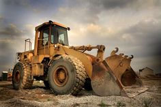 A front-end loader at a construction site - Equipment financing demystified.