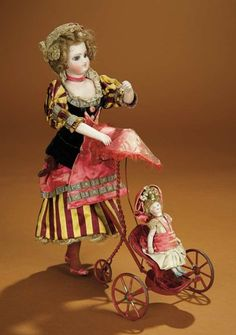 """12""""- French Mechanical Toy """"Little Girl Walking Her Doll"""" by Vichy~~Comments: Vichy, Paris, circa 1875, when the attached Vichy key is wound, the girl is designed to walk briskly along, thus pushing the carriage. Value Points: the rare toy presents a charming scene, each doll wearing its original well-detailed silk costume, with beautiful faces, perfect bisque hands on lady."""
