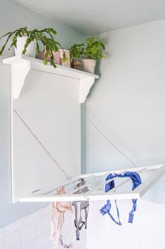 Make a DIY laundry rack with shelf. This combination drying rack and shelf gives you a bit of extra storage with your drying space.