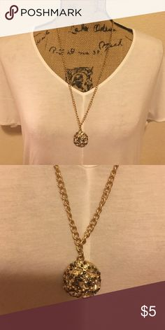 Gold necklace with black and clear rhinestones Long gold necklace with black and clear looking rhinestones on pendant.  There was an extra gold chain on it but that broke off, but it is still very pretty!  BUNDLE and SAVE! Charming Charlie Jewelry Necklaces
