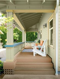 Exposed rafters overhead create a lofty feeling while colorful paint highlights other Craftsman-style details on this back porch. Craftsman Porch, Craftsman Style, Front Porch Posts, Front Porches, Mission Style Homes, Clapboard Siding, Exposed Rafters, Porch Addition, Porch Steps