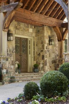 Love the stonework, and wood framing above doorway