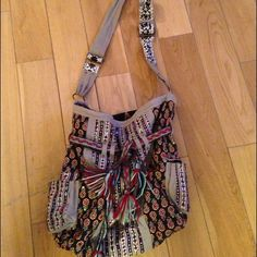 Free People messenger bag. Funky, boho chic messenger bag. Great for everyday use and can fit a lot of personal belongings. Free People Bags