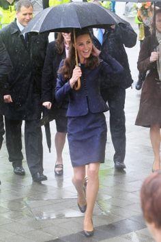 Kate Middleton #DuchessofCambridge Navy Blue suit in the rain with umbrella